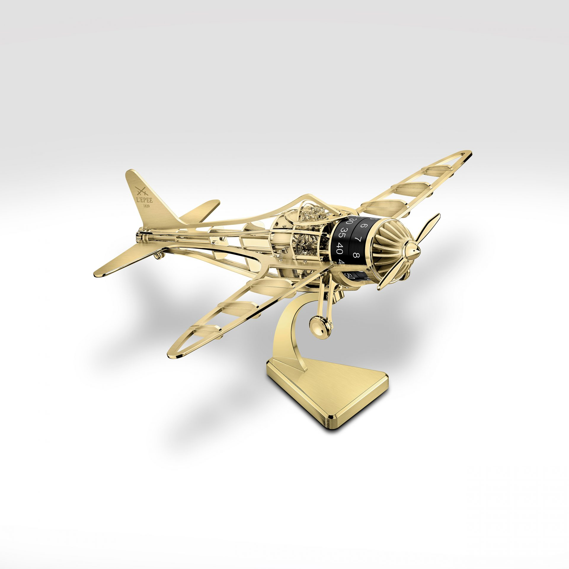 El avión Time Flies en la versión dorada con peana
